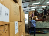 Staff load trucks with emergency aid for displaced persons in Al Jawf and Maareb. ICRC /S.. Ammane