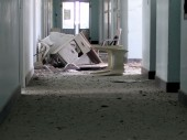 Taiz city, Al-Thawra hospital. Debris and pieces of furniture lie scattered in one of the hospital corridors.