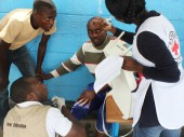 Zambia Red Cross Society volunteers attend to a patient in need of medical attention at a polling station in Zambia.
