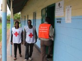 Zambia Red Cross Society volunteers at a polling station in Lusaka remain alert to the first aid needs of voters.