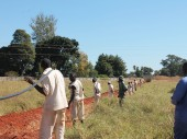 Prisoners at Chikurubi Farm Prison prepare to lay an armoured electric cable that will power the boreholes.