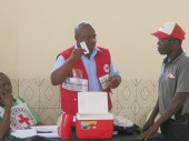 Mozambique Red Cross Society volunteers receive first aid kits and training on how to use them.