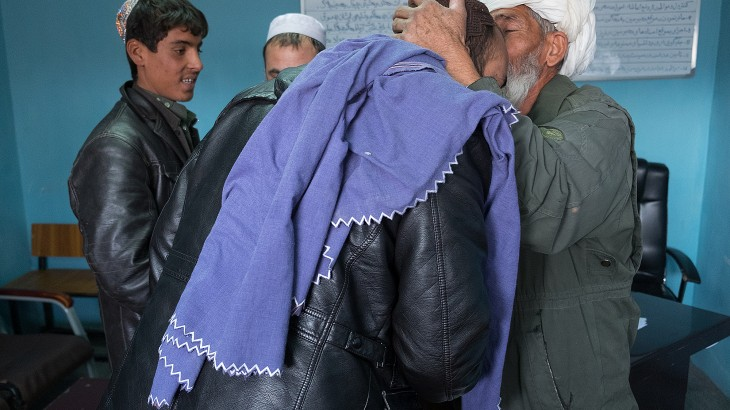 Afghanistan: Father embraces son-in-law for first time in years