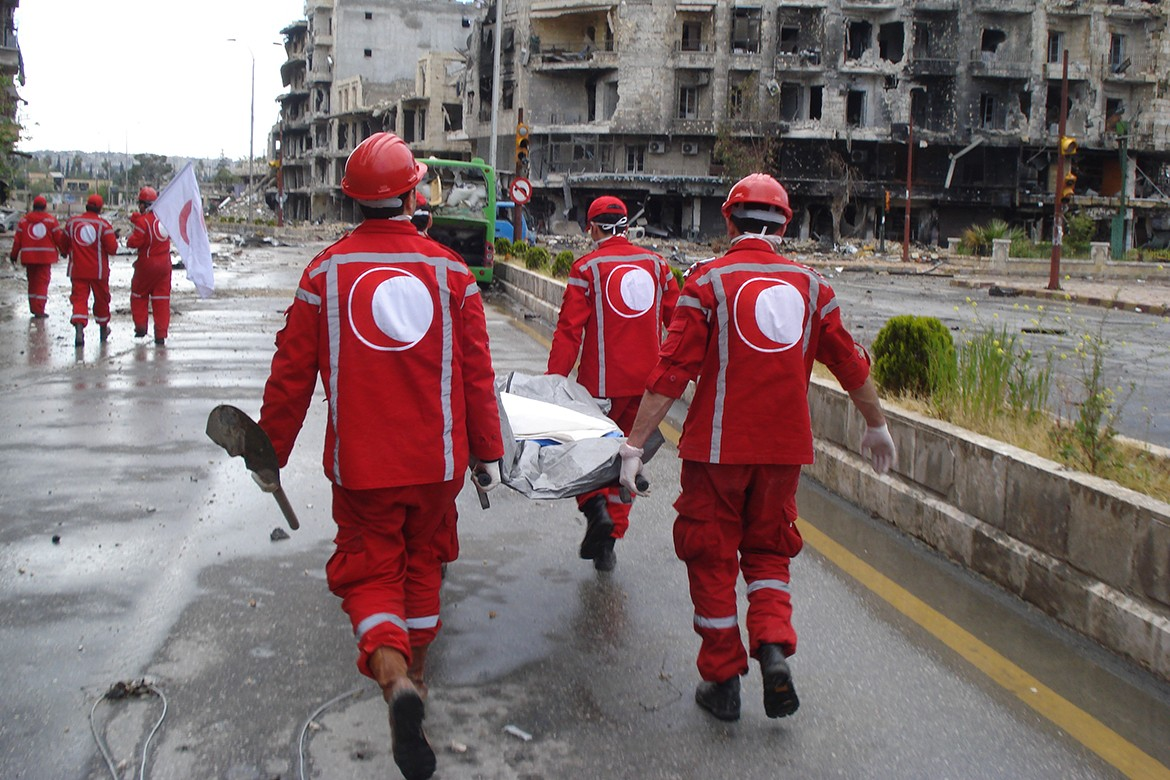 Red Crescent Volunteers retrieve bodies in the streets of Aleppo, Syria.