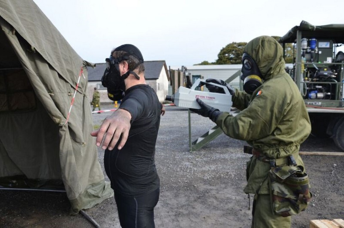 An Irish Army Sapper Uses A Chemical Detector To Check For Contamination  During The Decontamination Process