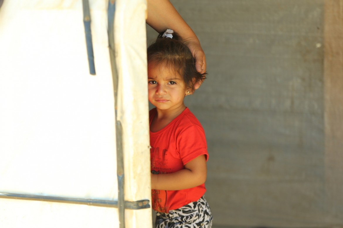 Rahaf, Um Khaled's two-year-old granddaughter, in their tent in Ras Baalbek, Lebanon, July 2015.