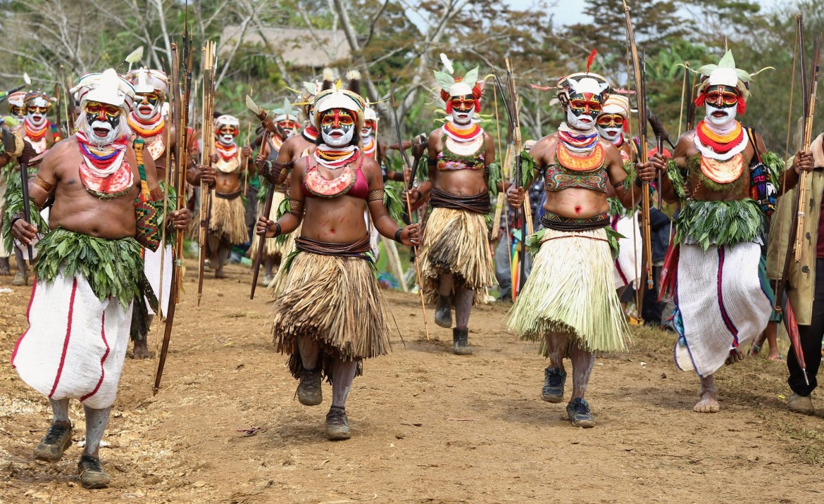 Papua New Guineans in full tribal costume welcome guests to Kalolo at the beginning of the day's festivities.