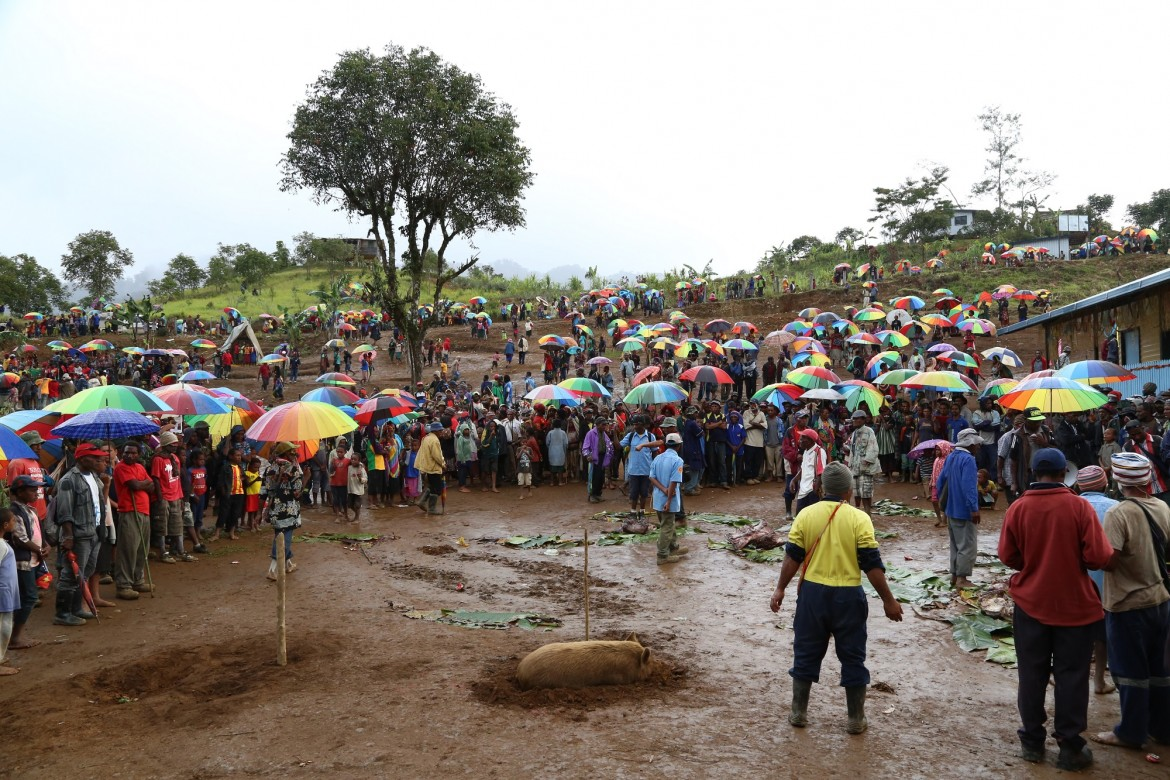 The scene in Kalolo at the end of the day, when the rains began and PNG's typical technicolor umbrellas came out.