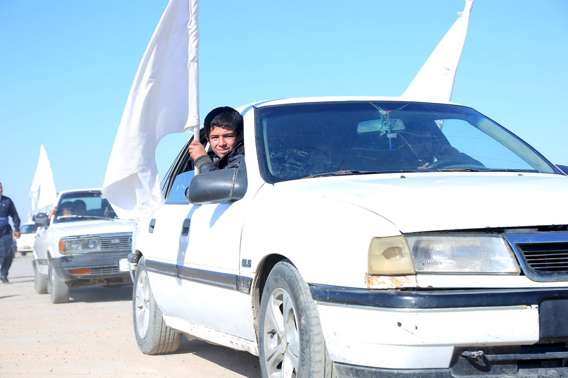 People fleeing the fighting continue to wave white flags, even as the danger has passed.