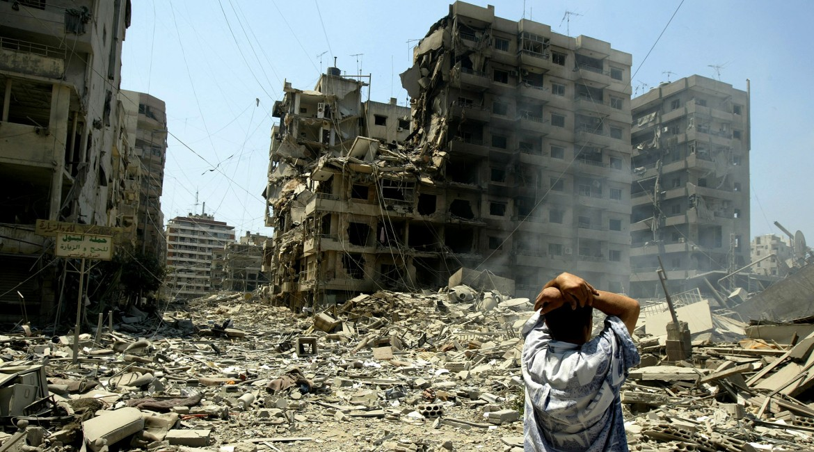 2006. Despair at the sight of the large-scale destruction of Beirut's suburbs.