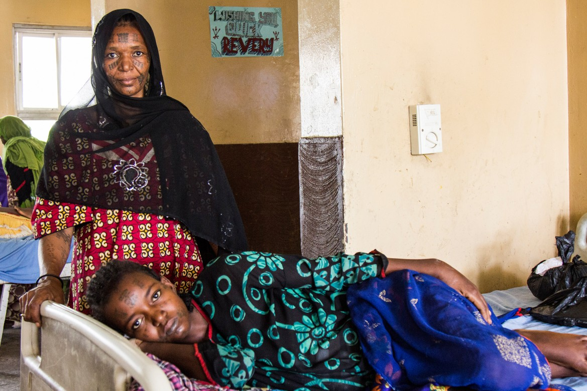 A mother watches over her sick daughter at Maiduguri Hospital.
