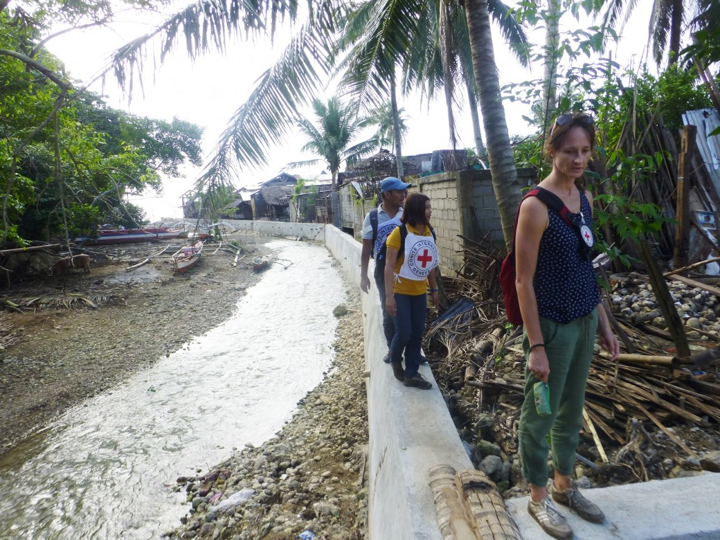 The cash-for-work program aimed at supporting livelihood recovery through construction of community projects that would benefit the entire community. Photo: The completed river wall project in Barangay Togoron, Monreal in Masbate. Photo by ICRC/J. Angolluan