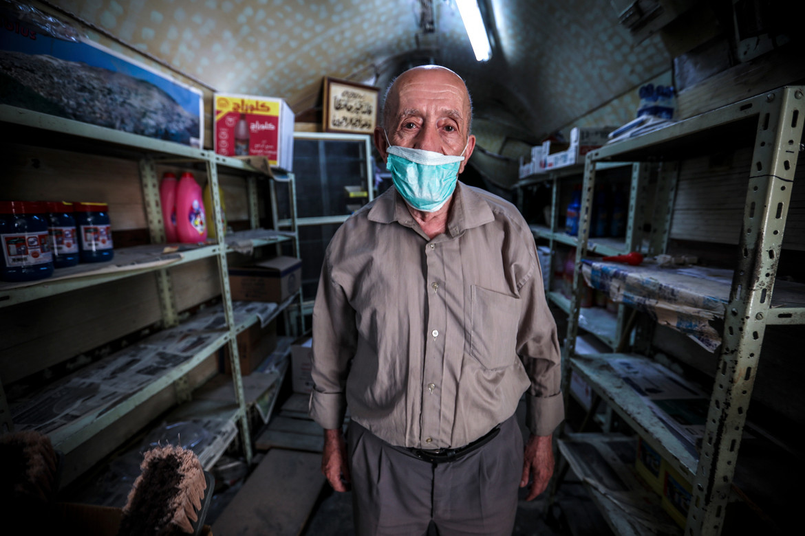 West Bank - Nablus. Haj Abdul Rahim Abu Ghazaleh, is the owner of a small grocery store in the old city which, prior to COVID-19 outbreak, was filled with visitors from other Palestinian cities