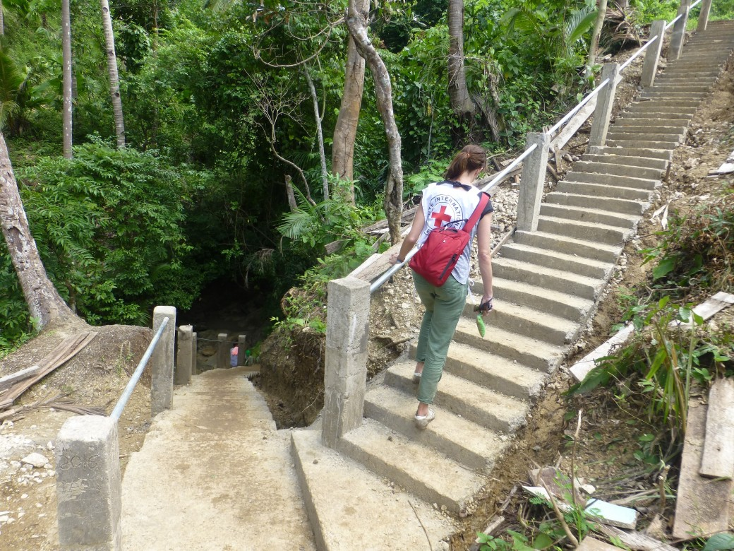 Cash-for-work projects are community-led which means the community initiate and manage responsibilities related to the effective implementation of the projects. Photo: Newly constructed concrete staircase leading up to the main water source in BarangayBartolabac, San Jacinto in Masbate. Photo by ICRC/J. Angolluan