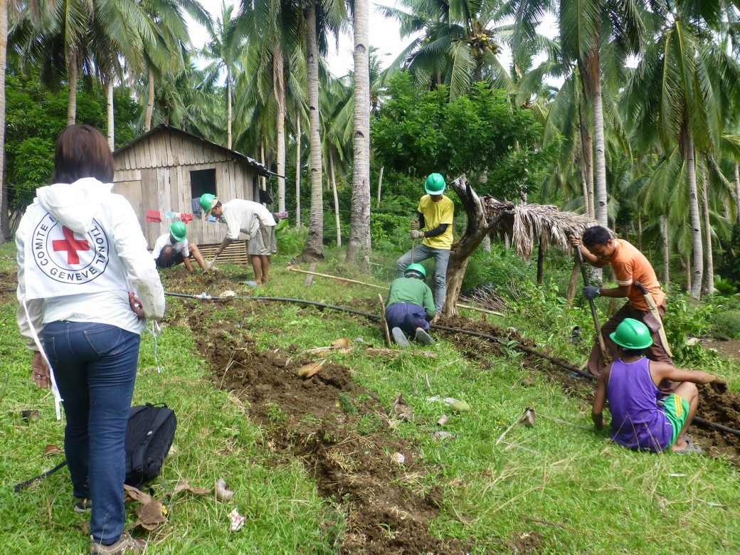 Workers bury  existing water pipelines to make sure these will not be damaged easily in Barangay Pinya, San Jacinto, Masbate. Photo by ICRC/J. Angolluan