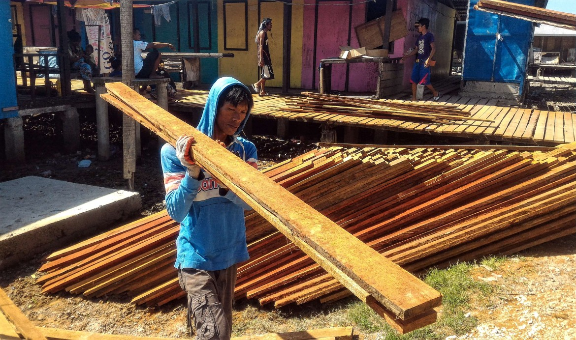 """I am so happy that our boardwalks are repaired; now we don't worry when our children play there. Everyone here feels comfortable to walk without fearing that the planks will break,"" said Omar Pangalasal, one of the participants in the cash-for-work program in Masepla, Mampang.  Photo by: PRC Zamboanga/ J. Gamboa"