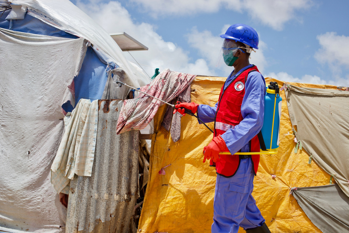 Somalia - A Somali Red Crescent staff disinfects tents in the Qaaboowe internally displaced camp in Mogadishu where COVID-19 outbreak could spread massively.