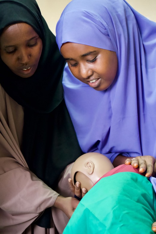 Fardosa Abdi Abdullahi (right), 24, Mogadishu, Banadir region. Experience as a midwife: Four years