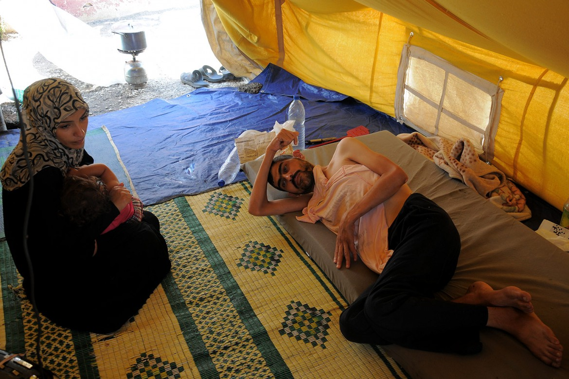 "This couple fled to Tartous to escape fighting and now live in a tent.  ""I sold all my belongings to move my sick husband to Tartous, and nothing is left to buy him medicines"", the wife explains."