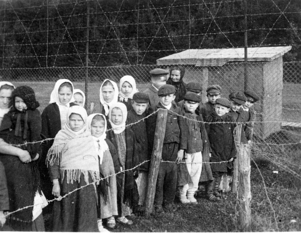 Children stare at a prisoner of war (POW) camp in Holzminden, Germany.