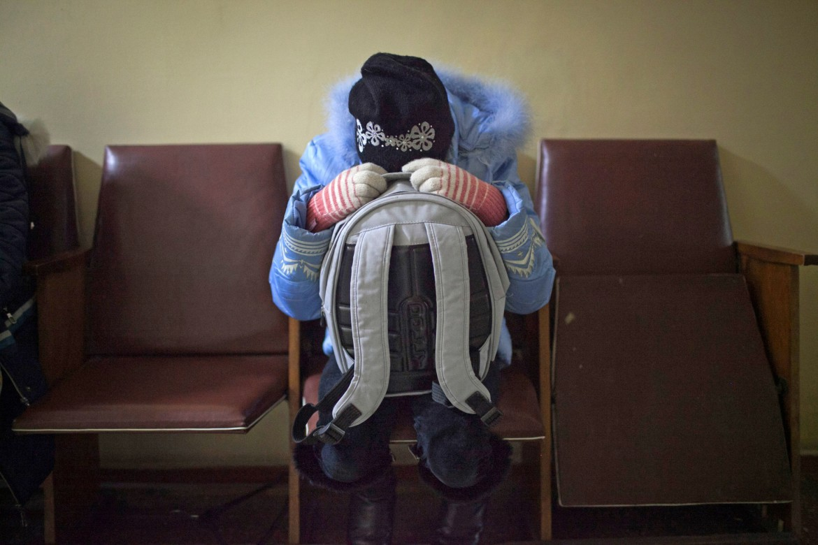 Donetsk, Ukraine, January 2015. A girl cowers in fear as shelling hits Hospital No. 3, which specializes in older people and children.