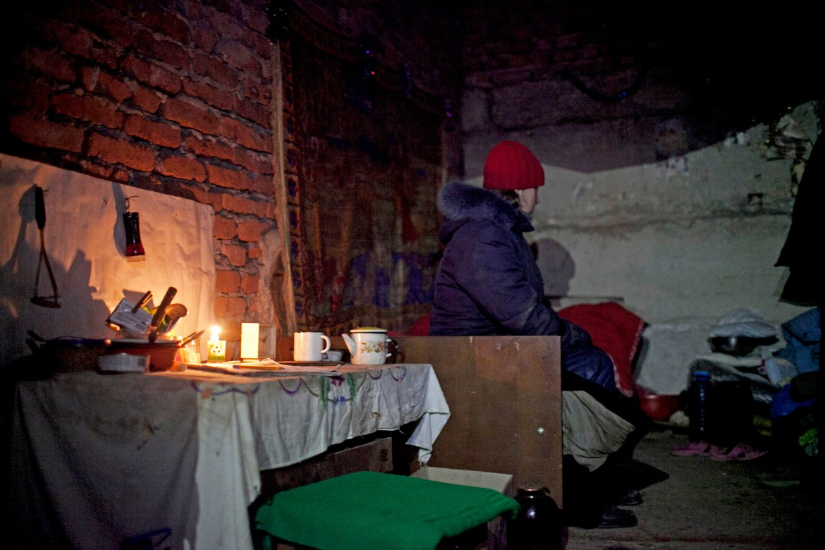 Donetsk, Ukraine, January 2015. A basement where people are living on the outskirts of the city, some 5 km from the ruined airport, as continuous shelling pounds the area. These people have had no electricity or running water for the last two weeks.
