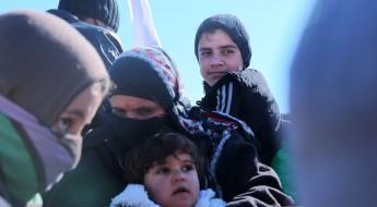 伊拉克:携家带口逃离摩苏尔的战火