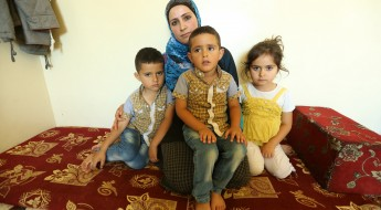 Lina with her three children in their makeshift home. Ras Baalbek, Lebanon, July 2015.