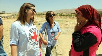ICRC personnel chat with Um Khaled, one of the Lebanese returnees. Ras Baalbek, Lebanon, July 2015.