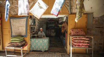 约旦河西岸地区:寂静的市场中希望与恐惧交织并存