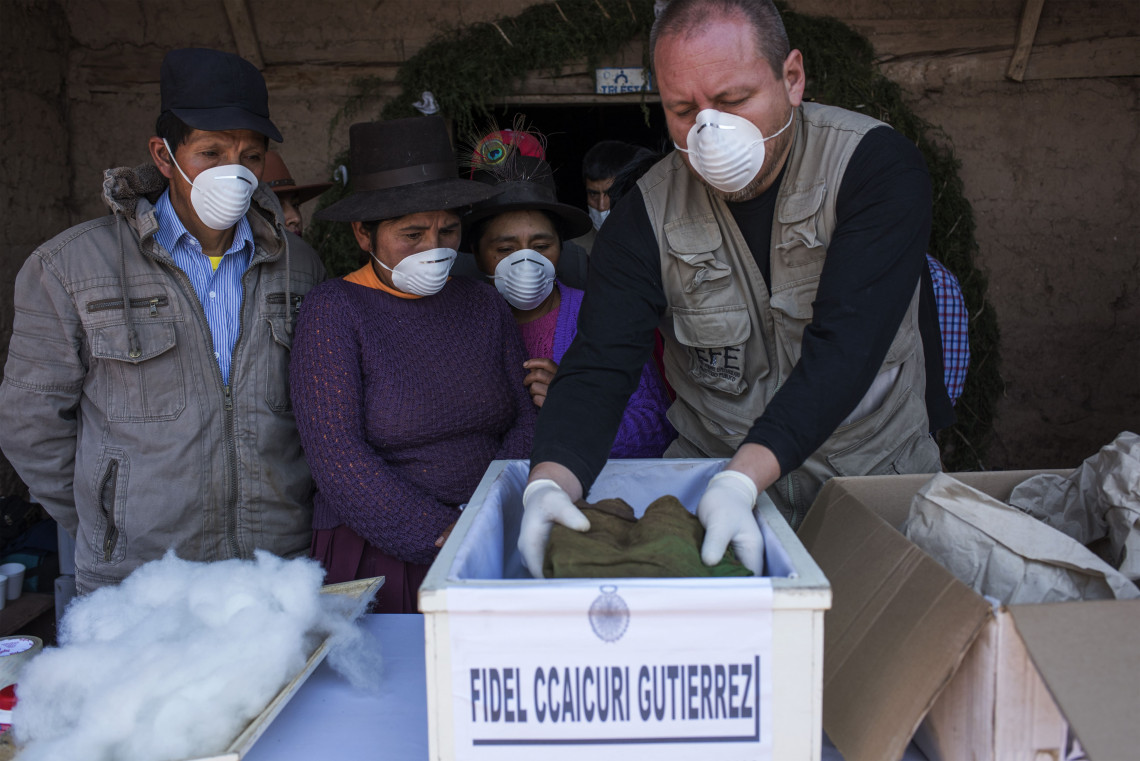 Ayacucho, Peru. The remains of people who disappeared 30 years ago are exhumed, identified and placed in small coffins in preparation for burial. Lucas Omar / ICRC
