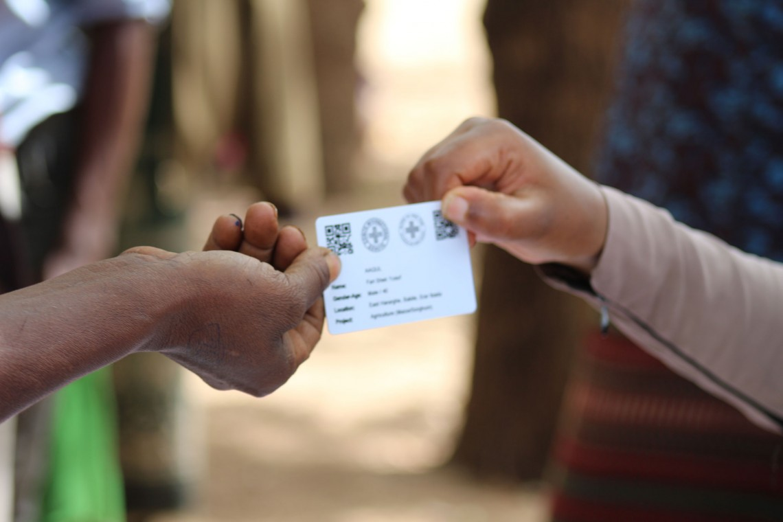 The newly introduced QR code identification cards that community members will use to access cash and seeds assistance from the ICRC in Ethiopia. Photo: ICRC