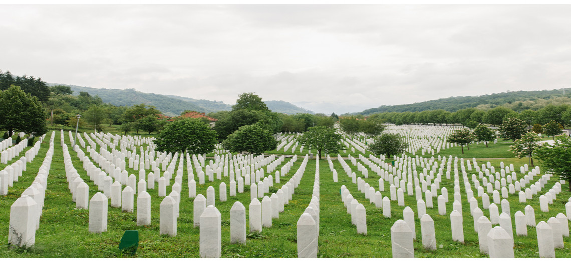 Empty places between the rows of tombstones are left at the Potočari Memorial for over 1,000 missing persons from Srebrenica to be buried beside their family members, once they are found and identified. K FAINGNAERT/ICRC