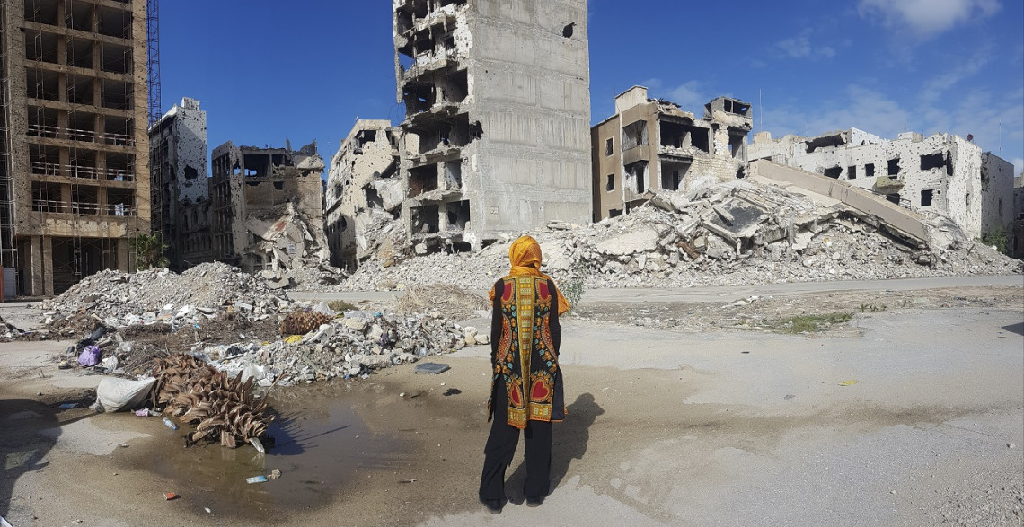 Benghazi. Patrizia Danzi, ICRC regional director for Africa, amid the ruins of the city / ICRC
