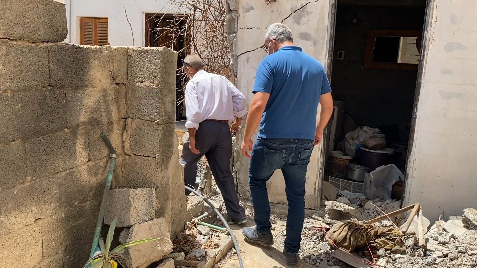 One of our colleagues checks the house of one of our beneficiaries which has been damaged by the conflict.