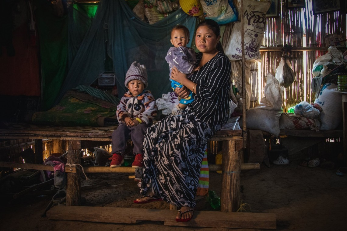 Ma Su Hlaing with her children in their house in Hsipaw, Myanmar: As a mother of two toddlers, Hsipaw resident Ma Su Hlaing has her hands full. But despite her long and tiring days, she occasionally takes out time to talk to community members about the risks related to unexploded ordnance and landmines. Two years ago, when Ma Su Hlaing was expecting her second baby and went into labour, her husband Kyaw Thet and his brother trekked to get some medicinal herbs from the nearby mountains. But the trip turned tragic when they stepped onto a mine and lost their lives. Left alone to take care of two young children, Ma Su Hlaing received some financial support from the ICRC to make ends meet. Today, like a few other members of the community in Shan state who work with the ICRC and Myanmar Red Cross Society to spread awareness about landmine-related risks, she warns about the dangers of making that trek to the mountains and advises people to be safe than sorry.