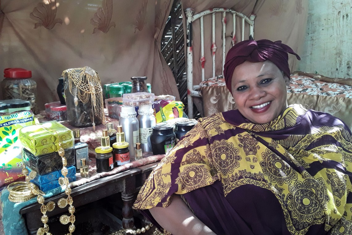 Rahama with her homemade perfumes and a selection of jewelry she hires out for weddings. Photo: Jessica Barry
