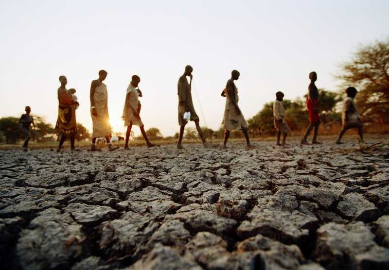 Drought-stricken victims leaving their village in search for water and food.