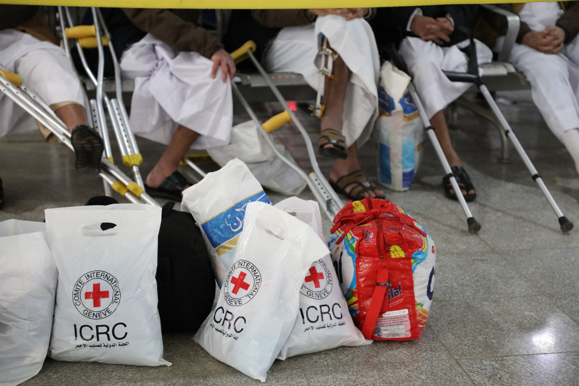 Former detainees wait to board the plane in Sana'a with relief items - ICRC/Osama Alansi
