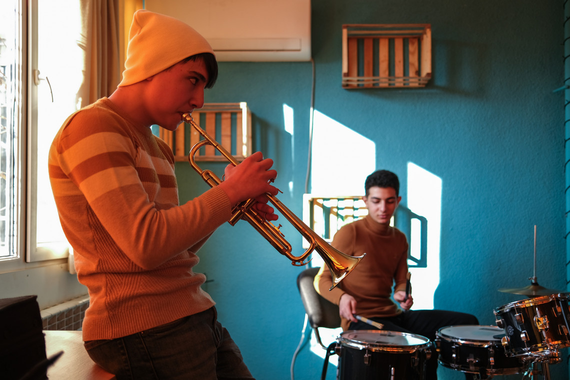 Making music in adversity: Vahagn and his friends at the local arts centre.