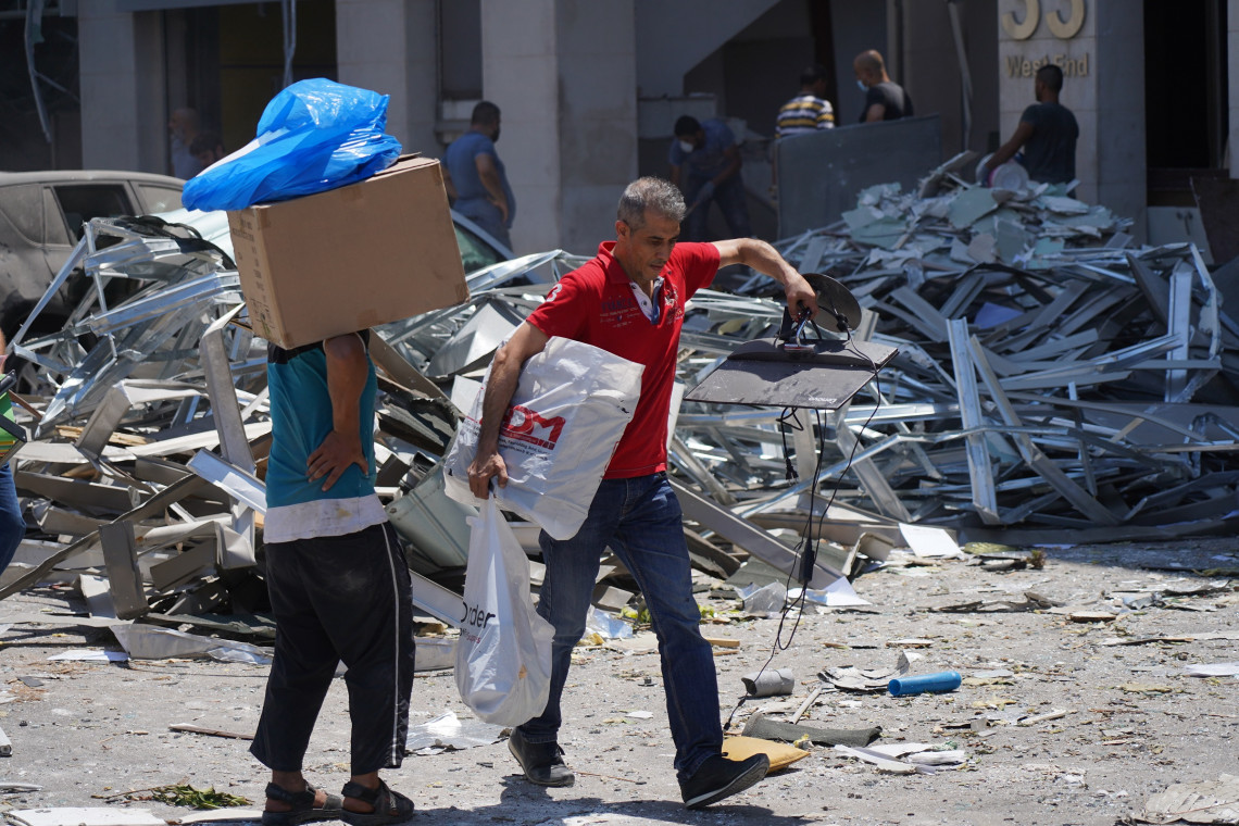 Persons picking up what was left in their homes and shops after the explosion.