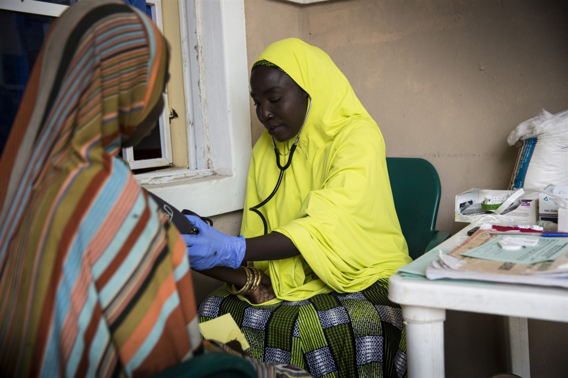 Borno State, town of Monguno. A woman receives a checkup at the maternal health section of a primary health clinic supported by the ICRC.