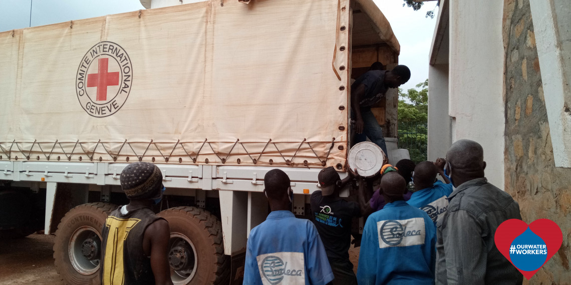 Bangui, Central African Republic. Water board workers offload chemicals imported from Cameroon. ICRC
