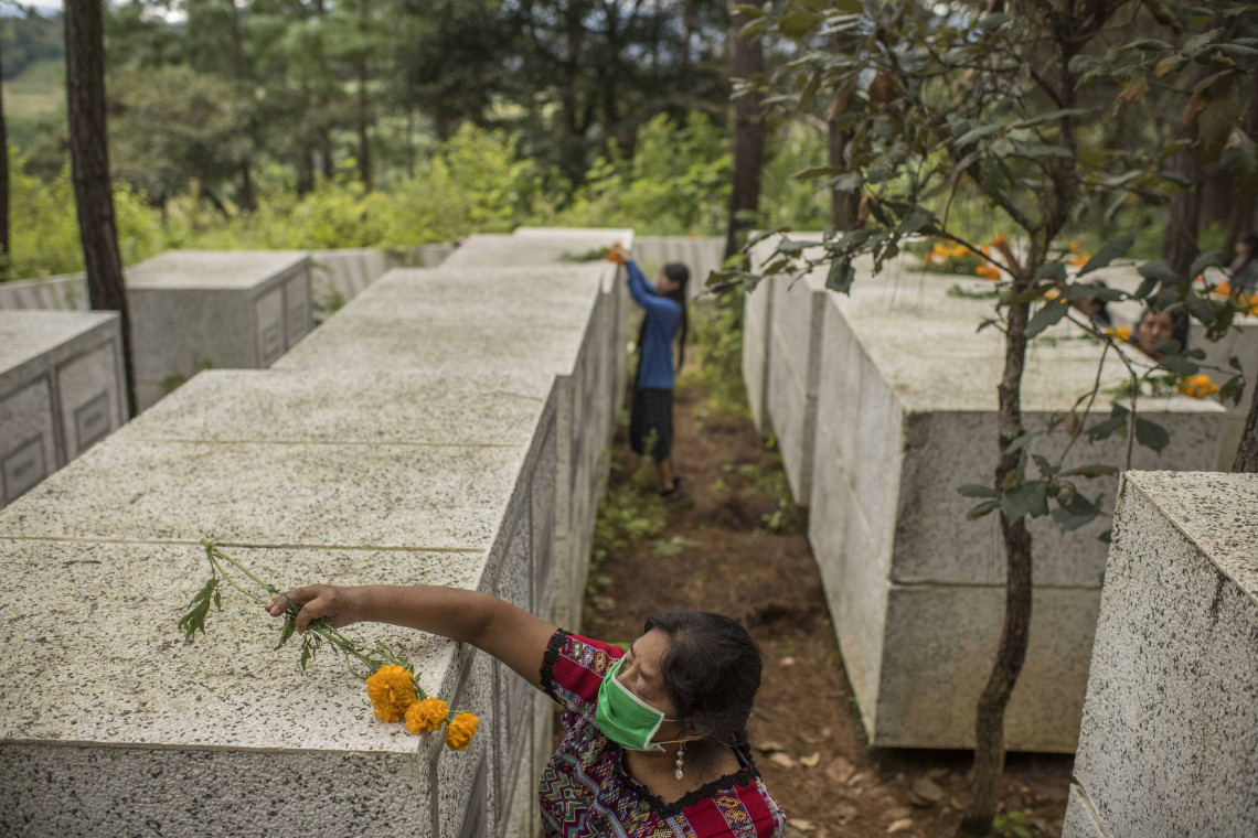 Rosalina Tuyuc, 64, and her family members decorate the graves where the remains of 220 victims of the armed conflict were found by forensic anthropologists. During the Civil War, the army took Rosalina's father and husband. To this day, Rosalina and her family still don't know the fate of their loved ones and continue to search for their remains.
