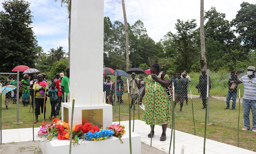 Margaret Sohun stands grieving in front of the monument of the missing persons as she pays her respect to her brother who went missing during the Bougainville crisis.
