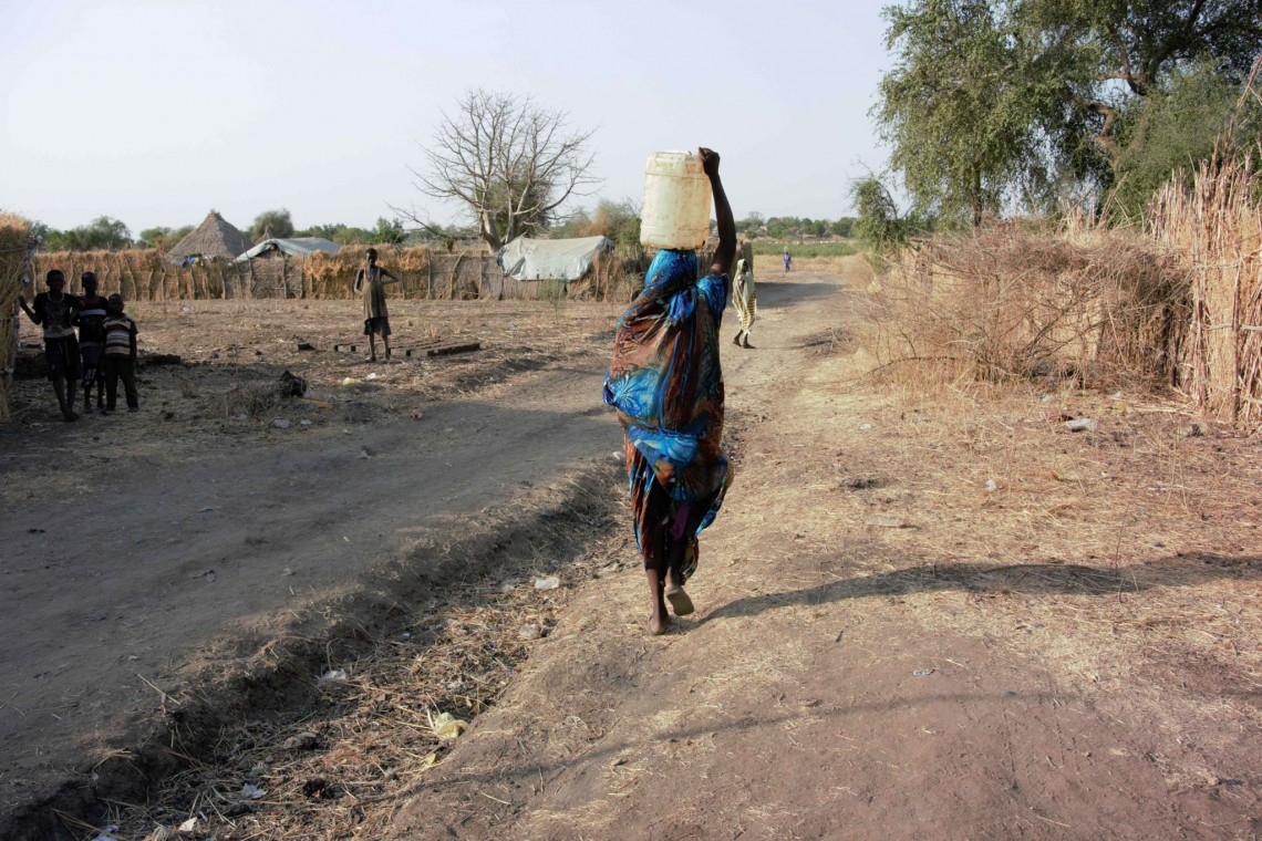 Suad's neighbor Susan walks for an hour a day to bring water from the river to her home. Photo: Jessica Barry / ICRC