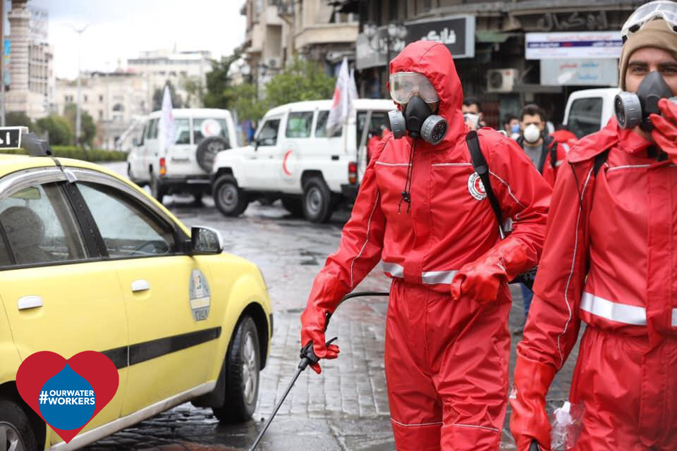 Syrian Arab red Crescent personnel carrying out a disinfection campaign in the streets of Damascus as part of the preventative measures against COVID-19. ICRC