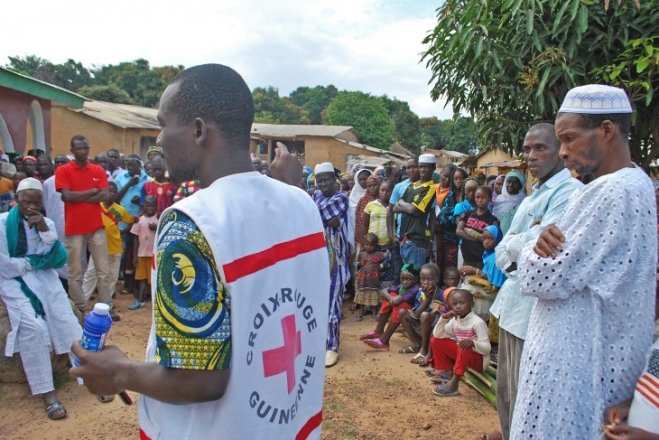 Guinea. A volunteer from the Red Cross Society of Guinea explains Ebola protection measures.