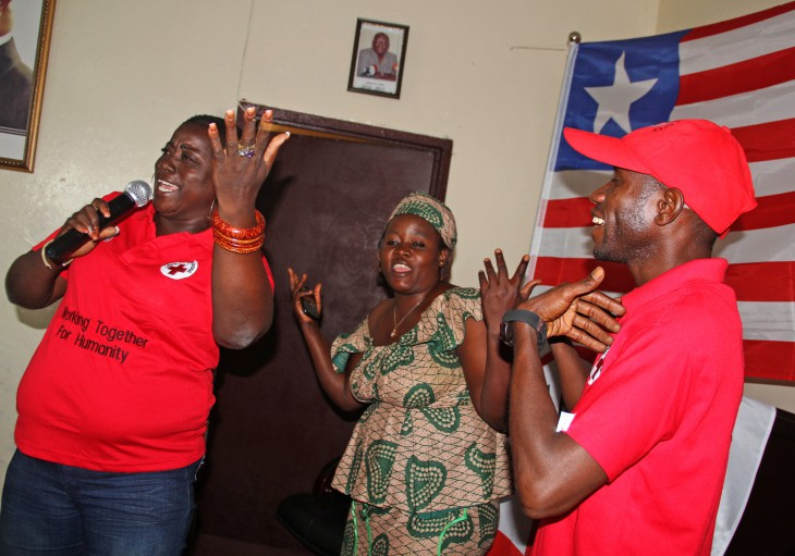 "Florence Jlopeh (left) with Ebola survivors Makuka Sirleaf and Gerald Dennis during the live performance of ""Let Us Live Together Again"""