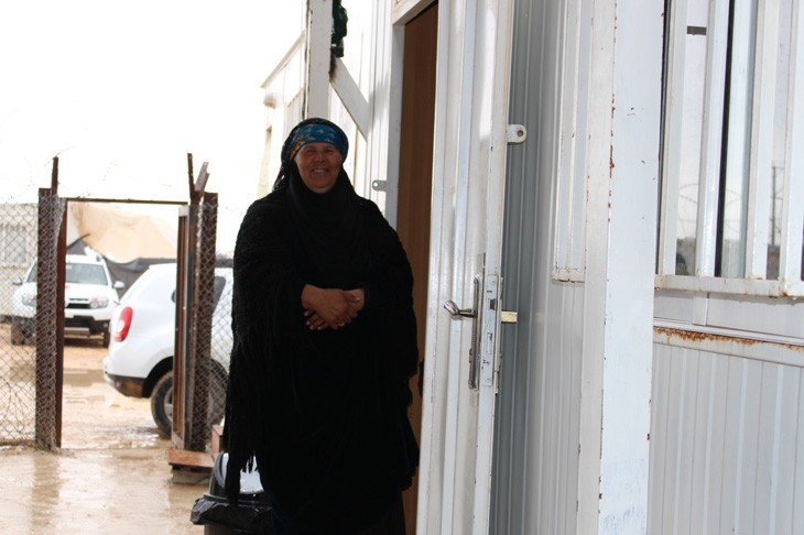 Zaatari refugee camp, Jordan.  A Syrian refugee leaves the ICRC office after making a phone call to relatives in Syria.